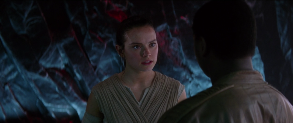 Rey in a cave with Finn